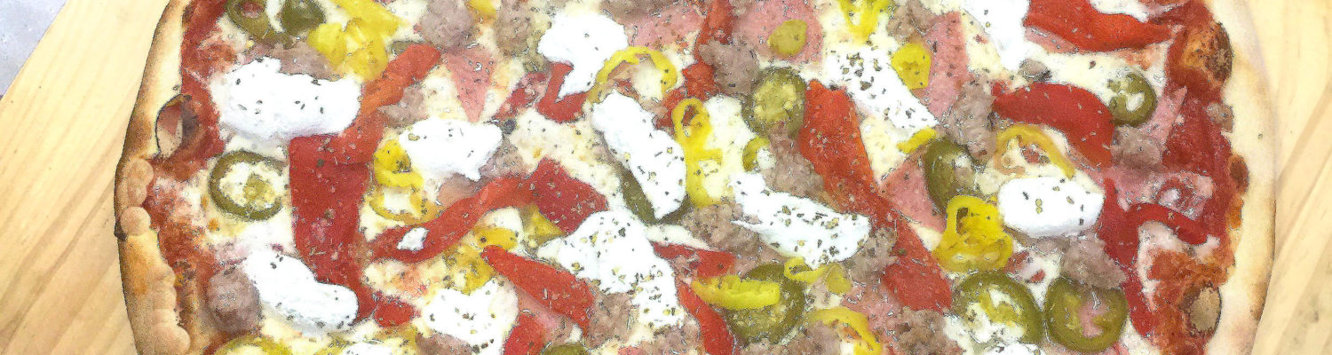 Victory Pizza's Pork Roll, Sausage, cherry, jalapeño & banana peppers with dollops creamy ricotta cheese.